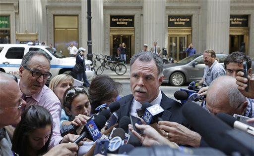 Chicago Police Superintendent Garry McCarthy speaks to the media outside a downtown high-rise office building following a shooting inside the building, Thursday, July 31, 2014, in Chicago. Police said a demoted worker shot and critically injured his company's CEO before fatally shooting himself. (AP Photo/M. Spencer Green)