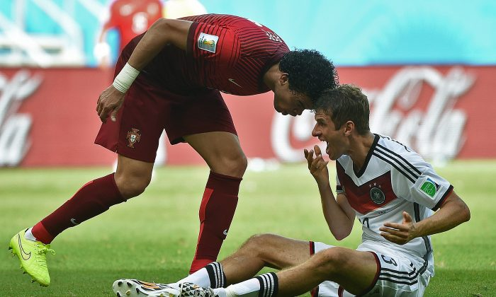 Portugal's defender Pepe (R) fouls Germany's forward Thomas Mueller before being sent off during the Group G football match between Germany and Portugal at the Fonte Nova Arena in Salvador during the 2014 FIFA World Cup on June 16, 2014. (PATRIK STOLLARZ/AFP/Getty Images)