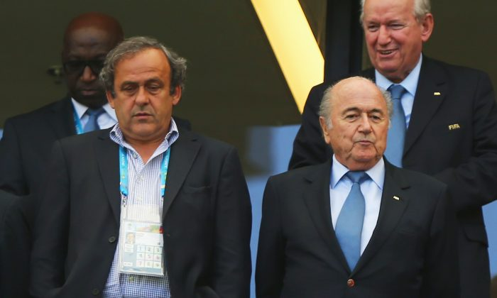 UEFA President Michel Platini (L) and FIFA President Joseph Blatter look on during the 2014 FIFA World Cup Brazil Group G match between Germany and Portugal at Arena Fonte Nova on June 16, 2014 in Salvador, Brazil. (Photo by Martin Rose/Getty Images)