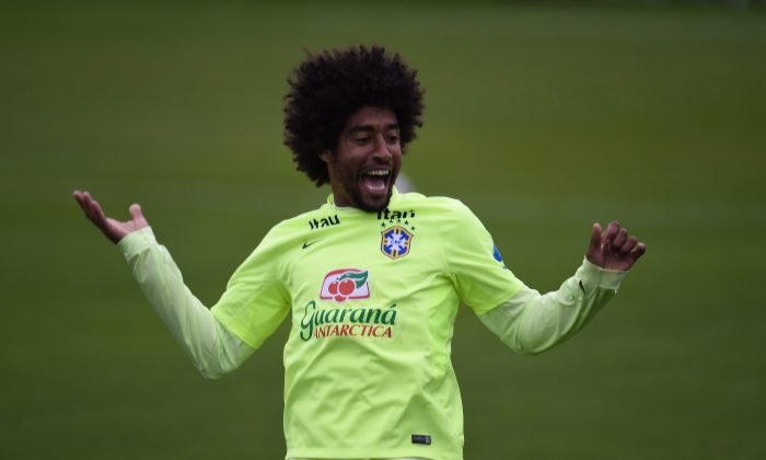 Brazil's defender Dante smiles during a training session in the squad's Granja Comary training complex in Teresopolis on June 20, 2014, during the 2014 FIFA World Cup in Brazil. (VANDERLEI ALMEIDA/AFP/Getty Images)