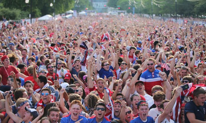 Fans in Grant Park celebrate a goal by the U.S. against Portugal in a Group G World Cup soccer match on June 22, 2014 in Chicago, Illinois. Fans were turned away from the free event after a 10,000-person capacity was reached. (Scott Olson/Getty Images)