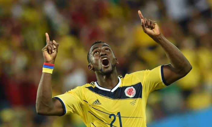 Colombia's forward Jackson Martinez celebrates after scoring his second goal during the Group C football match between Japan and Colombia at the Pantanal Arena in Cuiaba during the 2014 FIFA World Cup on June 24, 2014. (TOSHIFUMI KITAMURA/AFP/Getty Images)