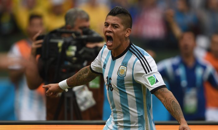 Argentina's defender Marcos Rojo celebrates his goal during a Group F football match between Nigeria and Argentina at the Beira-Rio Stadium in Porto Alegre during the 2014 FIFA World Cup on June 25, 2014. (PEDRO UGARTE/AFP/Getty Images)