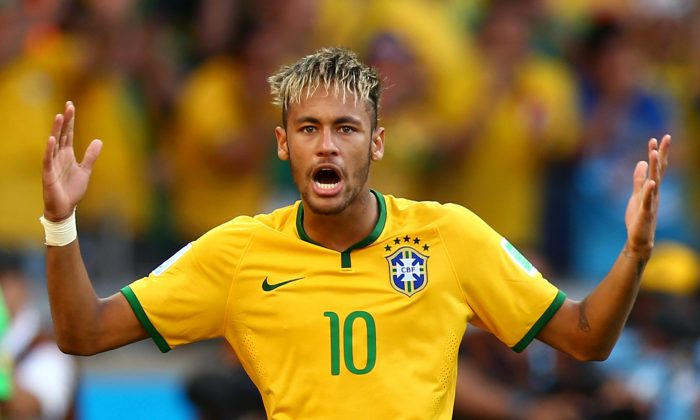 Neymar of Brazil celebrates after defeating Chile in a penalty shootout during the 2014 FIFA World Cup Brazil round of 16 match between Brazil and Chile at Estadio Mineirao on June 28, 2014 in Belo Horizonte, Brazil. (Photo by Ronald Martinez/Getty Images)