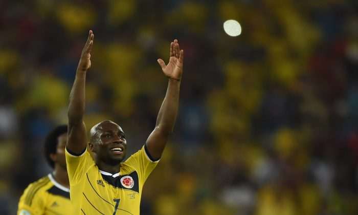 Colombia's defender Pablo Armero and his teammates celebrate after the Round of 16 football match between Colombia and Uruguay at the Maracana Stadium in Rio de Janeiro during the 2014 FIFA World Cup in Brazil on June 28, 2014. (EITAN ABRAMOVICH/AFP/Getty Images)