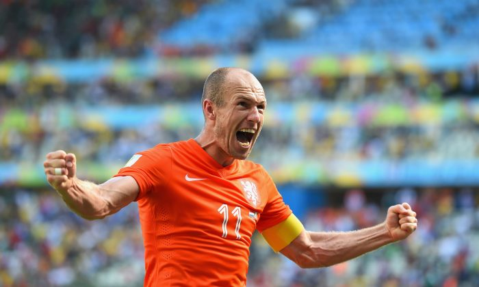 Arjen Robben of the Netherlands celebrates after defeating Mexico 2-1 during the 2014 FIFA World Cup Brazil Round of 16 match between Netherlands and Mexico at Castelao on June 29, 2014 in Fortaleza, Brazil. (Laurence Griffiths/Getty Images)
