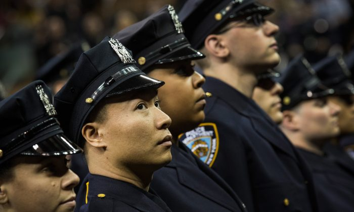 The 2014 class of the New York Police Department (NYPD) attend the NYPD graduation ceremony on June 30, 2014 at Madison Square Garden in New York City. The NYPD, which has over 35,000 officers, graduated 604 new officers today. (Andrew Burton/Getty Images)