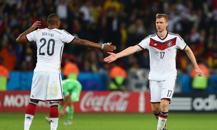 Jerome Boateng and Per Mertesacker of Germany celebrate their team's second goal in extra time during the 2014 FIFA World Cup Brazil Round of 16 match between Germany and Algeria at Estadio Beira-Rio on June 30, 2014 in Porto Alegre, Brazil. (Jamie Squire/Getty Images)
