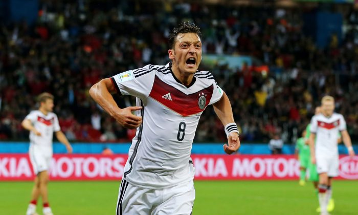 Mesut Oezil of Germany celebrates scoring his team's second goal in extra time during the 2014 FIFA World Cup Brazil Round of 16 match between Germany and Algeria at Estadio Beira-Rio on June 30, 2014 in Porto Alegre, Brazil. (Martin Rose/Getty Images)