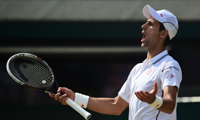 Serbia's Novak Djokovic appeals a decision during his men's singles quarter-final match against Croatia's Marin Cilic on day nine of the 2014 Wimbledon Championships at The All England Tennis Club in Wimbledon, southwest London, on July 2, 2014. Djokovic won 6-1, 3-6, 6-7, 6-2, 6-2. (CARL COURT/AFP/Getty Images)