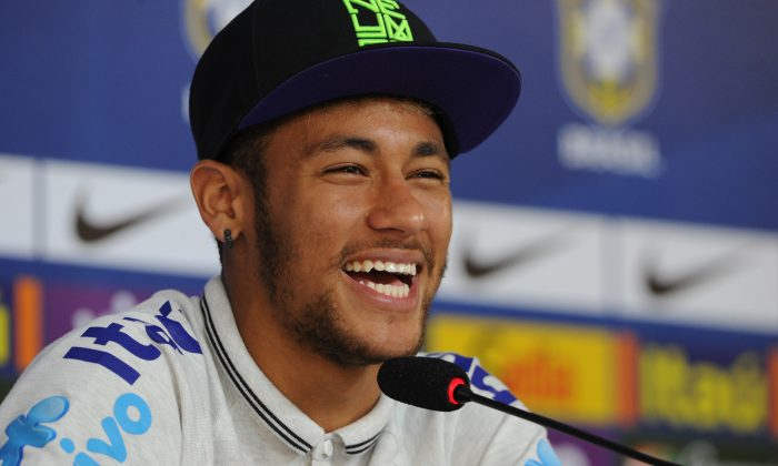 Brazil's Neymar smiles during a press conference in Teresopolis, Rio de Janeiro state, Brazil on July 2, 2014. (TASSO MARCELO/AFP/Getty Images)