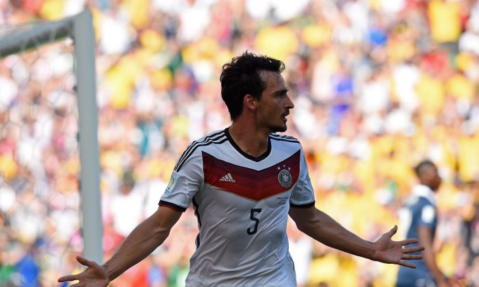 Germany's defender Mats Hummels celebrates after scoring a goal during the quarter-final football match between France and Germany at the Maracana Stadium in Rio de Janeiro during the 2014 FIFA World Cup on July 4, 2014. (FRANCK FIFE/AFP/Getty Images)