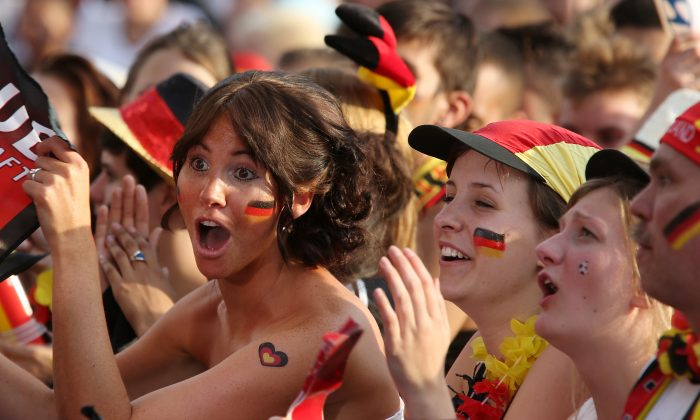 Fans of Germany watch the 2014 FIFA World Cup Brazil quarter final match between Germany and France at the Fanmeile public viewing at Brandenburg Gate, in Berlin, Germany, on July 4, 2014. (Matthias Kern/Bongarts/Getty Images)