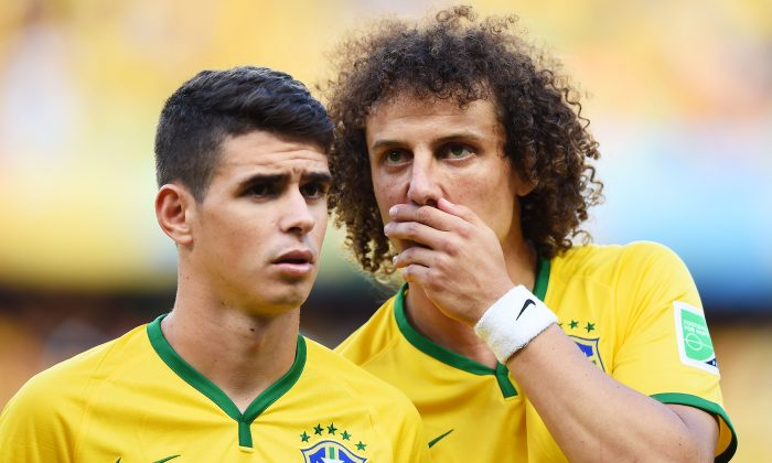 Oscar (L) and David Luiz of Brazil look on during the 2014 FIFA World Cup Brazil Quarter Final match between Brazil and Colombia at Castelao on July 4, 2014 in Fortaleza, Brazil. (Laurence Griffiths/Getty Images)