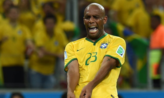 Brazil's defender Maicon gestures during the quarter-final football match between Brazil and Colombia at the Castelao Stadium in Fortaleza during the 2014 FIFA World Cup on July 4, 2014. (VANDERLEI ALMEIDA/AFP/Getty Images)