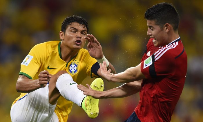 Colombia's midfielder James Rodriguez (R) vies with Brazil's defender and captain Thiago Silva during the quarter-final football match between Brazil and Colombia at the Castelao Stadium in Fortaleza during the 2014 FIFA World Cup on July 4, 2014. (FABRICE COFFRINI/AFP/Getty Images)