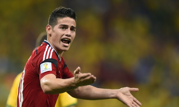 Colombia's midfielder James Rodriguez celebrates after scoring during the quarter-final football match between Brazil and Colombia at the Castelao Stadium in Fortaleza during the 2014 FIFA World Cup on July 4, 2014. (FABRICE COFFRINI/AFP/Getty Images)