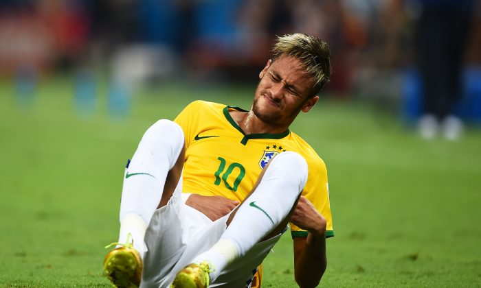 Neymar of Brazil reacts after a challenge during the 2014 FIFA World Cup Brazil Quarter Final match between Brazil and Colombia at Castelao on July 4, 2014 in Fortaleza, Brazil. (Laurence Griffiths/Getty Images)