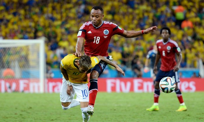 Neymar of Brazil is challenged by Juan Camilo Zuniga of Colombia during the 2014 FIFA World Cup Brazil Quarter Final match between Brazil and Colombia at Castelao on July 4, 2014 in Fortaleza, Brazil. This tackle resulted in injury to Neymar and ended the player's World Cup. (Jamie McDonald/Getty Images)