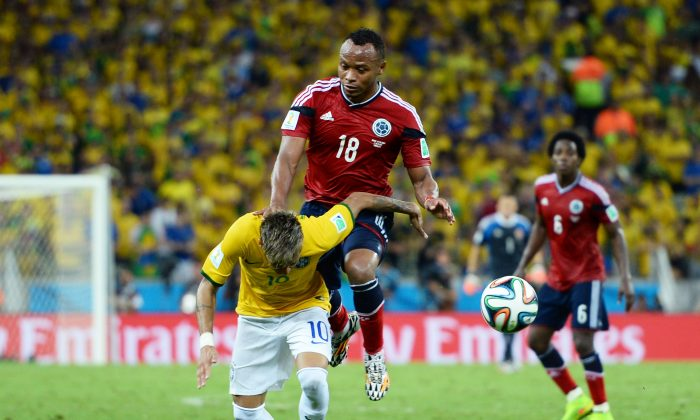 Neymar of Brazil is challenged by Juan Camilo Zuniga of Colombia during the 2014 FIFA World Cup Brazil Quarter Final match between Brazil and Colombia at Castelao on July 4, 2014 in Fortaleza, Brazil. (Jamie McDonald/Getty Images)