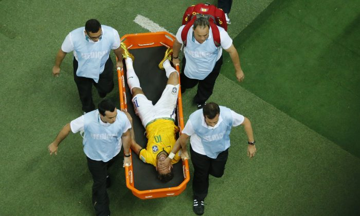 Brazil's forward Neymar (C) reacts in pain as he is carried on a stretcher after being injured during the quarter-final football match between Brazil and Colombia at the Castelao Stadium in Fortaleza during the 2014 FIFA World Cup on July 4, 2014. (FABRIZIO BENSCH/AFP/Getty Images)