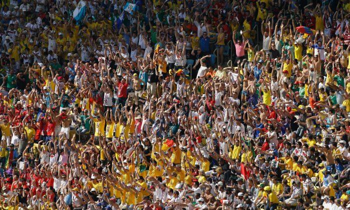 Fans cheer during the 2014 FIFA World Cup Brazil Quarter Final match between France and Germany at Maracana on July 4, 2014 in Rio de Janeiro, Brazil. (Matt Dunham/Getty Images)