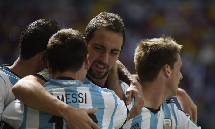 Argentina's forward Gonzalo Higuain (C) celebrates with teammates after scoring during a quarter-final football match between Argentina and Belgium at the Mane Garrincha National Stadium in Brasilia during the 2014 FIFA World Cup on July 5, 2014. (MARTIN BUREAU/AFP/Getty Images)