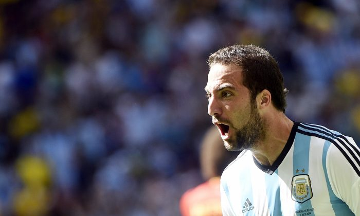 Argentina's forward Gonzalo Higuain celebrates after scoring during a quarter-final football match between Argentina and Belgium at the Mane Garrincha National Stadium in Brasilia during the 2014 FIFA World Cup on July 5, 2014. (MARTIN BUREAU/AFP/Getty Images)