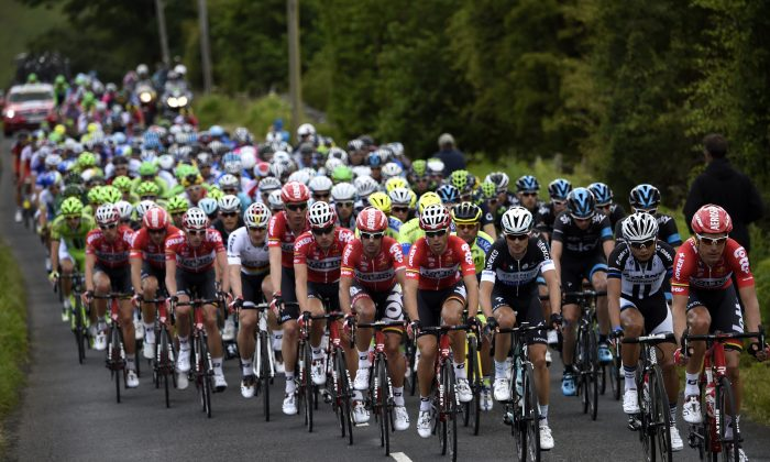 The pack rides during the 190.5 km first stage of the 101st edition of the Tour de France cycling race on July 5, 2014 between Leeds and Harrogate, northern England. The 2014 Tour de France gets underway on July 5 in the streets of Leeds and ends on July 27 down the Champs-Elysees in Paris. (ERIC FEFERBERG/AFP/Getty Images)