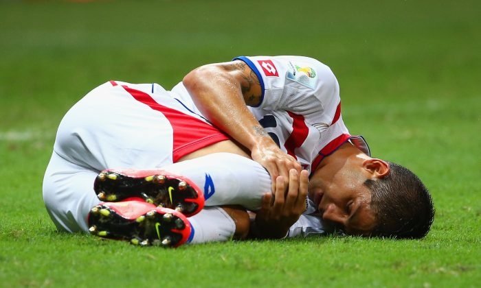 Cristian Gamboa of Costa Rica lies on the pitch during the 2014 FIFA World Cup Brazil Quarter Final match between the Netherlands and Costa Rica at Arena Fonte Nova on July 5, 2014 in Salvador, Brazil. (Photo by Robert Cianflone/Getty Images)