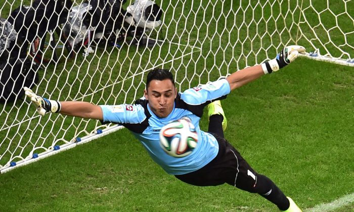 Costa Rica's goalkeeper Keylor Navas jumps to make a save during a quarter-final football match between Netherlands and Costa Rica at the Fonte Nova Arena in Salvador during the 2014 FIFA World Cup on July 5, 2014. (GABRIEL BOUYS/AFP/Getty Images)