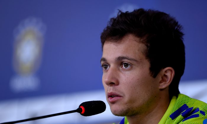 Bernard speaks during a press conference of the Brazilian national football team at the squad's Granja Comary training complex, on July 06, 2014 in Teresopolis, 90 km from downtown Rio de Janeiro, Brazil. (Photo by Buda Mendes/Getty Images)