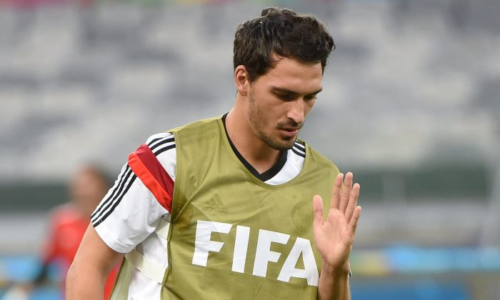 Germany's defender Mats Hummels warms up during a training session at The Mineirao Stadium in Belo Horizonte on July 7, 2014 on the eve of their 2014 FIFA World Cup semi-final against Brazil. (PATRIK STOLLARZ/AFP/Getty Images)