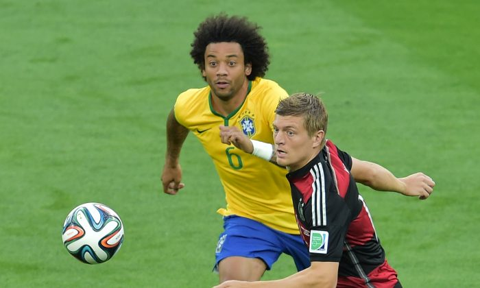 Brazil's defender Marcelo (L) vies with Germany's midfielder Toni Kroos during the semi-final football match between Brazil and Germany at The Mineirao Stadium in Belo Horizonte during the 2014 FIFA World Cup on July 8, 2014. (GABRIEL BOUYS/AFP/Getty Images)