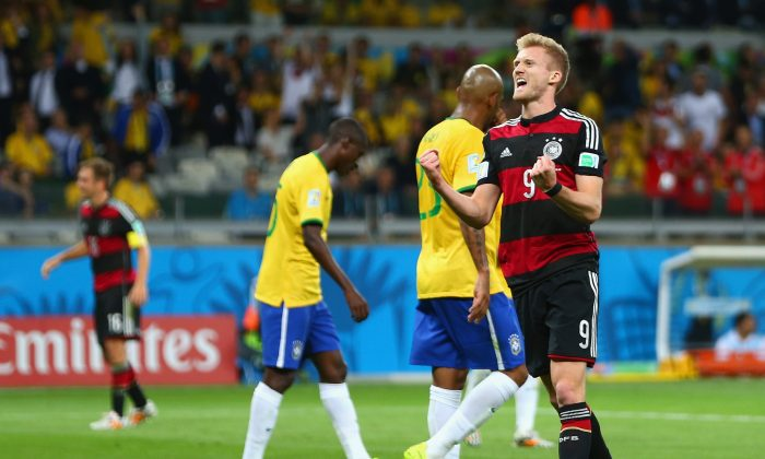 Andre Schuerrle of Germany celebrates scoring his team's sixth goal during the 2014 FIFA World Cup Brazil Semi Final match between Brazil and Germany at Estadio Mineirao on July 8, 2014 in Belo Horizonte, Brazil. (Michael Steele/Getty Images)