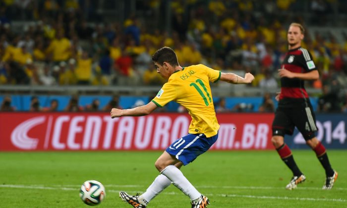 Oscar of Brazil shoots and scores his team's first goal during the 2014 FIFA World Cup Brazil Semi Final match between Brazil and Germany at Estadio Mineirao on July 8, 2014 in Belo Horizonte, Brazil. (Buda Mendes/Getty Images)