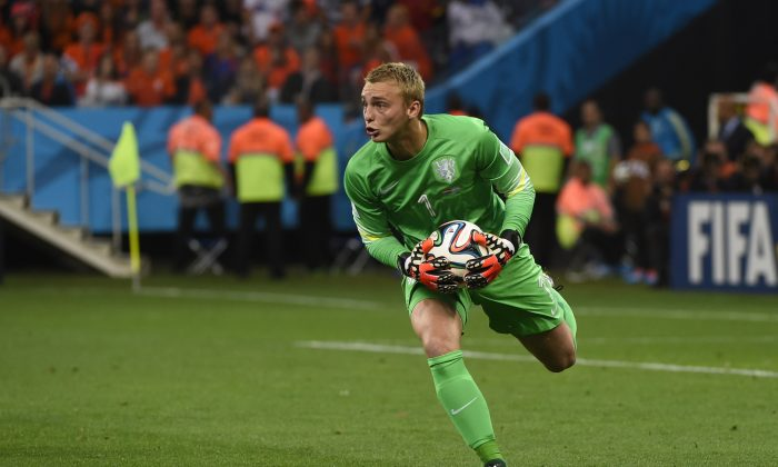 Netherlands' goalkeeper Jasper Cillessen gathers the ball during the semi-final football match between Netherlands and Argentina of the FIFA World Cup at The Corinthians Arena in Sao Paulo on July 9, 2014. (PEDRO UGARTE/AFP/Getty Images)