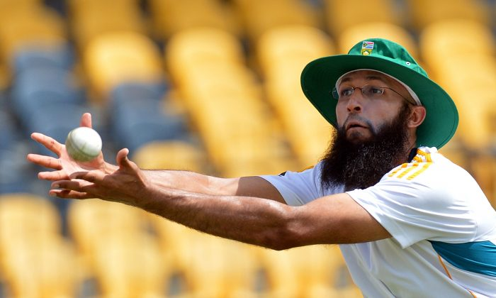 South African cricketer Hashim Amla takes a catch during a practice session at the Mahinda Rajapaksa International Cricket Stadium in Hambantota on July 11, 2014. The third and final One Day International (ODI) between South Africa and Sri Lanka will be played on July 12 at the Mahinda Rajapaksa International Cricket Stadium in Hambantota. (Getty Images)