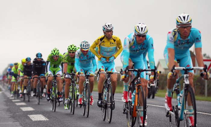 Race leader Vincenzo Nibali of Italy and the Astana Pro Team puts on his rain jacket during the seventh stage of the 2014 Tour de France, a 235km stage between Epernay and Nancy, on July 11, 2014 in Nancy, France. (Bryn Lennon/Getty Images)