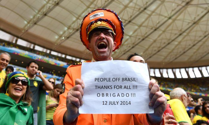 A fan holds a banner during the 2014 FIFA World Cup Brazil Third Place Playoff match between Brazil and the Netherlands at Estadio Nacional on July 12, 2014 in Brasilia, Brazil. (Buda Mendes/Getty Images)