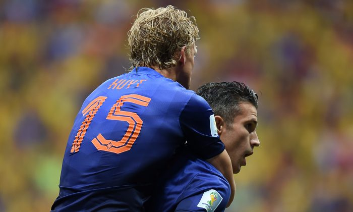 Netherlands' forward and captain Robin van Persie (R) celebrates with Netherlands' defender Dirk Kuyt after scoring a goal during the third place play-off football match between Brazil and Netherlands during the 2014 FIFA World Cup at the National Stadium in Brasilia on July 12, 2014. (Vanderlei Almeida/AFP/Getty Images)
