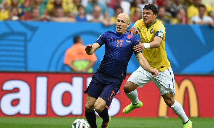 Netherlands' forward Arjen Robben (L) is fouled by Brazil's defender and captain Thiago Silva in the penalty area during the third place play-off football match between Brazil and Netherlands during the 2014 FIFA World Cup at the National Stadium in Brasilia on July 12, 2014. (VANDERLEI ALMEIDA/AFP/Getty Images)