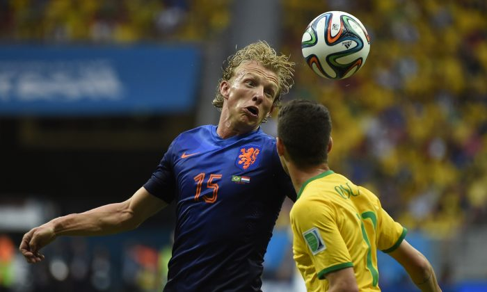 Netherlands' defender Dirk Kuyt (L) and Brazil's midfielder Oscar vie during the third place play-off football match between Brazil and Netherlands during the 2014 FIFA World Cup at the National Stadium in Brasilia on July 12, 2014. (ODD ANDERSEN/AFP/Getty Images)