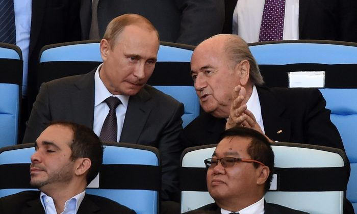 Russian President Vladimir Putin (L) and FIFA President Joseph Blatter attend the 2014 FIFA World Cup final football match between Germany and Argentina at the Maracana Stadium in Rio de Janeiro, Brazil, on July 13, 2014. (PEDRO UGARTE/AFP/Getty Images)