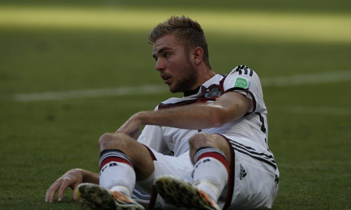 Germany's midfielder Christoph Kramer lies on the ground following a tackle during the 2014 FIFA World Cup final football match between Germany and Argentina at the Maracana Stadium in Rio de Janeiro, Brazil, on July 13, 2014. (ADRIAN DENNIS/AFP/Getty Images)