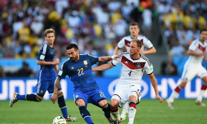 Ezequiel Lavezzi of Argentina competes for the ball with Benedikt Hoewedes of Germany during the 2014 FIFA World Cup Brazil Final match between Germany and Argentina at Maracana on July 13, 2014 in Rio de Janeiro, Brazil. (Jamie McDonald/Getty Images)
