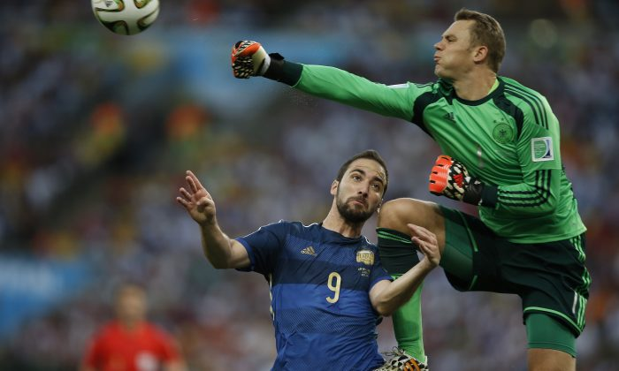 Argentina's forward Gonzalo Higuain (L) and Germany's goalkeeper Manuel Neuer vie for the ball during the 2014 FIFA World Cup final football match between Germany and Argentina at the Maracana Stadium in Rio de Janeiro, Brazil, on July 13, 2014. (ADRIAN DENNIS/AFP/Getty Images)
