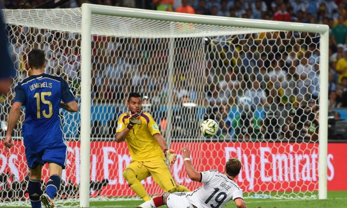Mario Goetze of Germany scores his team's first goal past Sergio Romero of Argentina in extra time during the 2014 FIFA World Cup Brazil Final match between Germany and Argentina at Maracana on July 13, 2014 in Rio de Janeiro, Brazil. (Matthias Hangst/Getty Images)