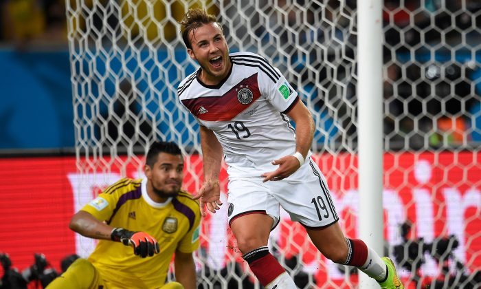 Germany's forward Mario Goetze (R) celebrates after scoring during the final football match between Germany and Argentina for the FIFA World Cup at The Maracana Stadium in Rio de Janeiro on July 13, 2014. (Odd Andersen/AFP/Getty Images)