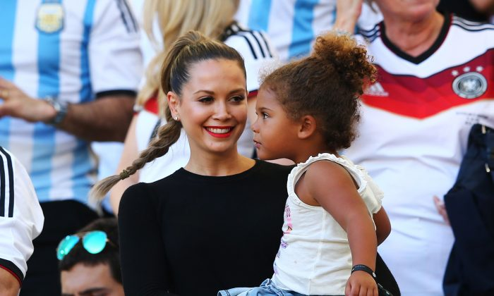Mandy Capristo, girlfriend of Mesut Oezil, holds Jerome Boateng's daughter during the 2014 FIFA World Cup Brazil Final match between Germany and Argentina at Maracana on July 13, 2014 in Rio de Janeiro, Brazil. (Photo by Martin Rose/Getty Images)